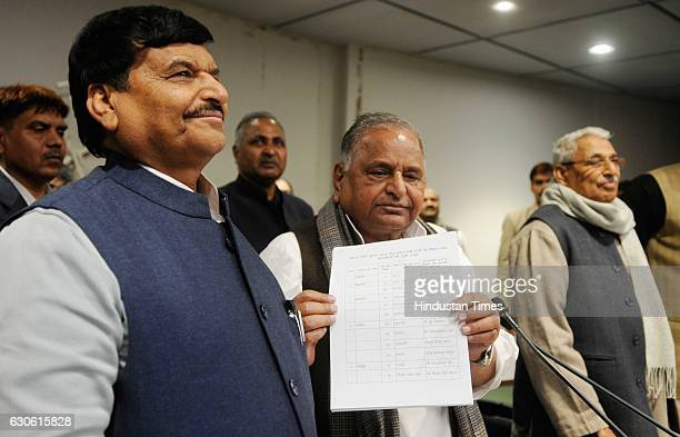 Chief Mulayam Singh Yadav with SP leader Shivpal Yadav showing list of 325 candidates who will be the face of Samajwadi Party in upcoming Vidhan...