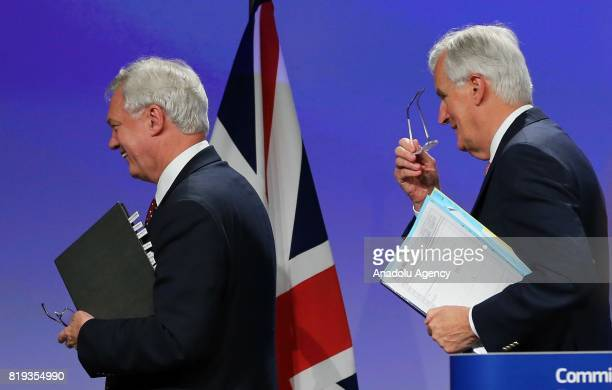 Chief negotiator for the European Union Michel Barnier and Secretary of State for Exiting the European Union David Davis leave the conference hall...