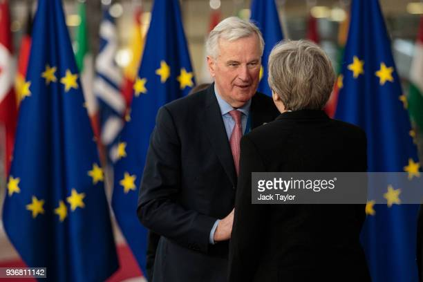 Chief negotiator for the European Union Michel Barnier greets British Prime Minster Theresa May on arrival at the Council of the European Union on...
