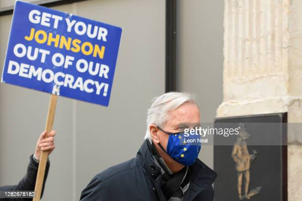 Chief negotiator Michel Barnier is followed by proEU campaigner Steve Bray as he walks to his hotel during a break in talks on October 28 2020 in...