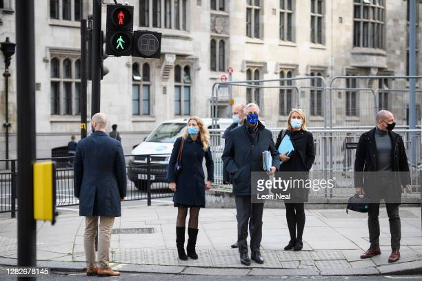 Chief negotiator Michel Barnier stands a pedestrian crossing as he walks to his hotel during a break in talks on October 28 2020 in London England...