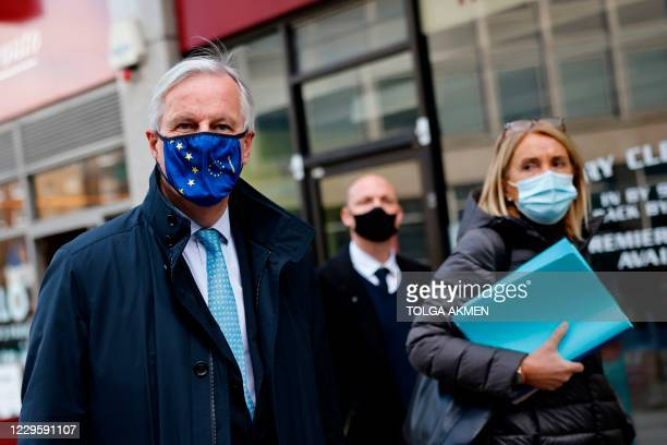 Chief negotiator Michel Barnier wearing a face mask because of the novel coronavirus pandemic leaves a conference centre as talks continue between...