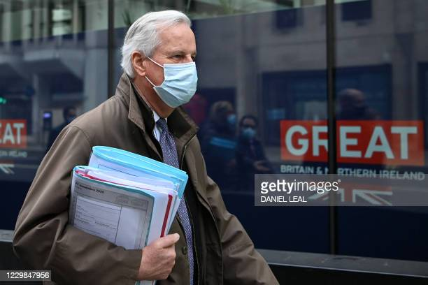 EU chief negotiator Michel Barnier wearing a protective face covering to combat the spread of the coronavirus walks to a conference centre to...