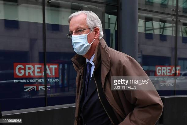Chief negotiator Michel Barnier, wearing a protective face covering to combat the spread of the coronavirus, leaves a conference centre in central...