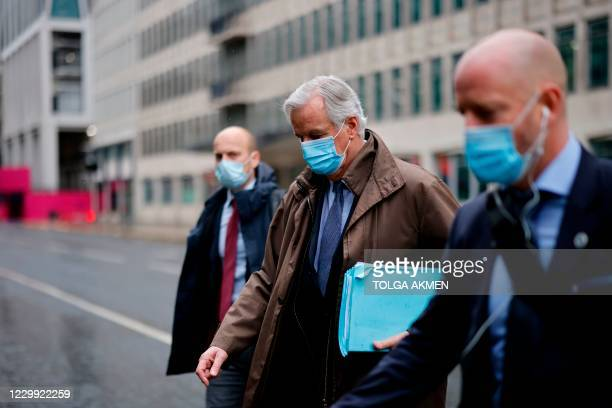 Chief negotiator Michel Barnier, , wearing a protective face covering to combat the spread of the coronavirus, walks to a conference centre in...