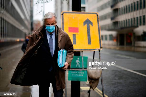 Chief negotiator Michel Barnier, wearing a protective face covering to combat the spread of the coronavirus, walks to a conference centre in central...