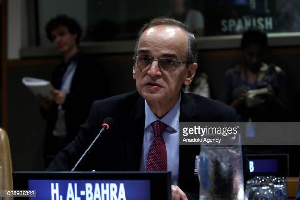 Chief negotiator of the Syrian Coalition's delegation to Geneva Hadi AlBahra makes a speech during a meeting with members of United Nations Security...