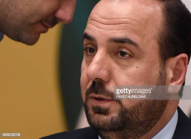 Chief negotiator of the Syrian Negotiation Commission Nasr alHariri speaks during a press conference in the Saudi capital Riyadh on March 17 2018 The...