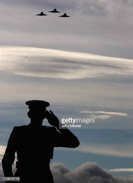 Chief of Air Staff Air Marshal Sir Stephen Dalton salutes a flypast from Typhoons during the fRAF 111 Fighter Squadron disbandment parade at RAF...