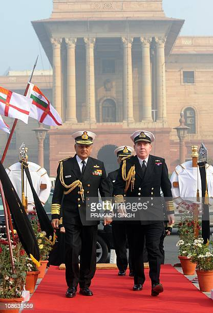 Chief of British Naval Staff Admiral Sir Mark Stanhope and Indian Navy Chief Admiral Nirmal Verma arrive for a meeting in New Delhi on January 31...