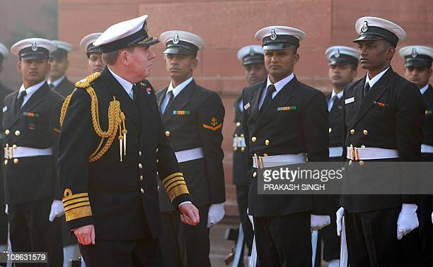 Chief of British Naval Staff Admiral Sir Mark Stanhope inspects the guard of honor prior to a meeting with Indian Navy Chief Admiral Nirmal Verma in...