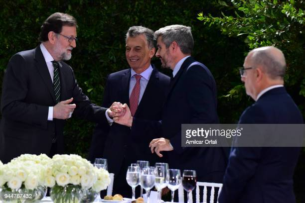 Chief of Cabinet Marcos Peña greets Prime Minister of Spain Mariano Rajoy and President of Argentina Mauricio Macri during the first day of the...