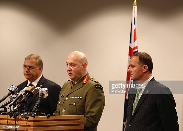 Chief of Defence Force LieutenantGeneral Rhys Jones speaks alongside Prime Minister John Key and Minister of Defence Wayne Mapp during a media...