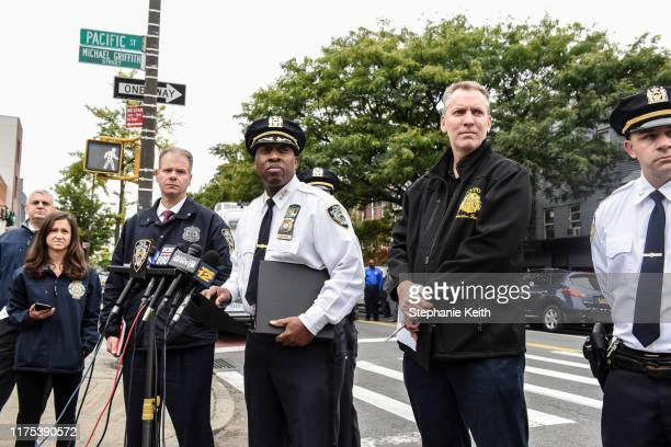 Chief of Detectives Dermot Shea and NYPD Chief of Patrol Rodney Harrison deliver remarks at a crime scene in front of the Triple A Aces social club...
