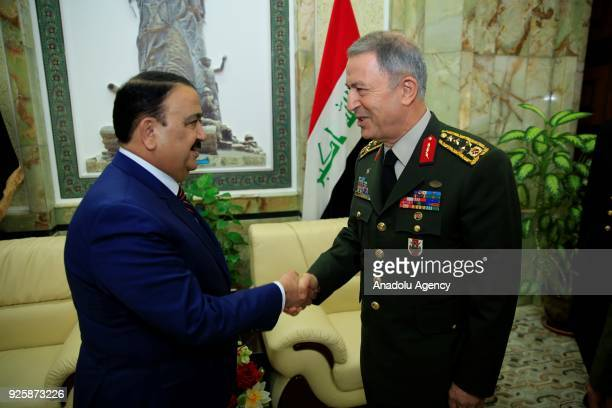 Chief of General Staff of Turkish Armed Forces Gen Hulusi Akar shakes hands with Secretary of Defense of Iraq Erfan alHiyali following an official...