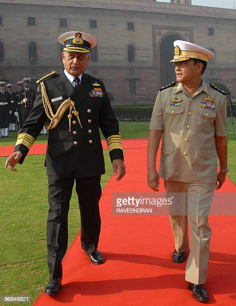 Chief of Indian Naval Staff Admiral Nirmal Kumar Verma talks with CommanderinChief of the Myanmar Navy Vice Admiral Nyan Tun during a ceremonial...