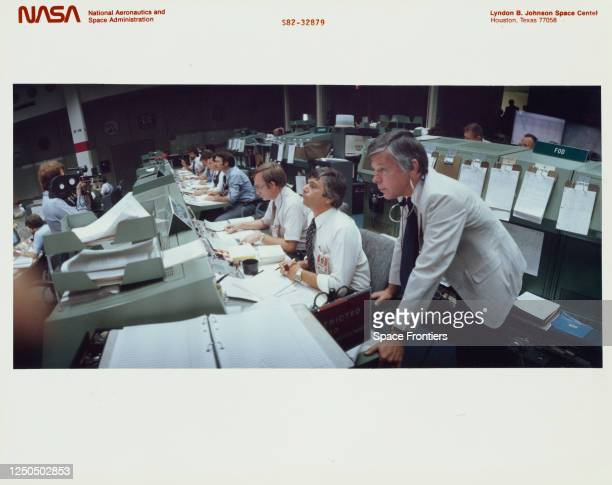 Chief of Johnson Space Center's flight control division M P Frank and flight controllers including Jay H Greene, Thomas W Holloway, S David Griggs...