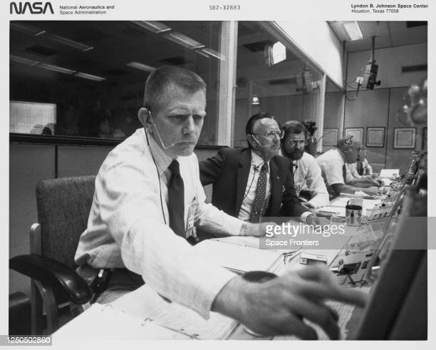 Chief of Johnson Space Center's flight control division M P Frank and flight controllers and flight controllers including S David Griggs Robert L...