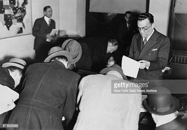 Chief of Justice Department J Edgar Hoover reading the confession of Milne's kidnap hoax to reporters