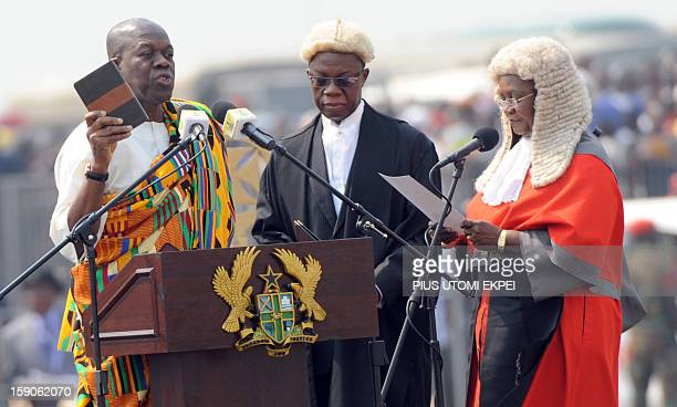 Chief of Justice Georgina Wood watches as Vice President Kwesi AmissahArthur takes oath holding the Bible at Independence Square Accra on January 7...