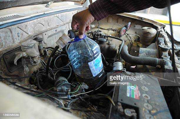 Chief of licensing of the Sol Plaatje municipality Moses Alfonse inspects a leaking fuel bottle which provides the carburetor with petrol in the...