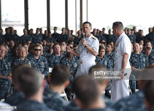 Chief of Naval Operations CNO Admiral John Richardson answers a Sailor's question during an allhands call at Kilo Pier Pearl Harbor Image courtesy...
