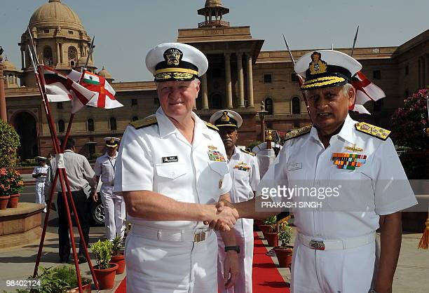 Chief of Naval Operations US Navy Admiral Dary Roughead shakes hands with Indian navy Chief Admiral Nirmal Verma as they review an honour guard in...