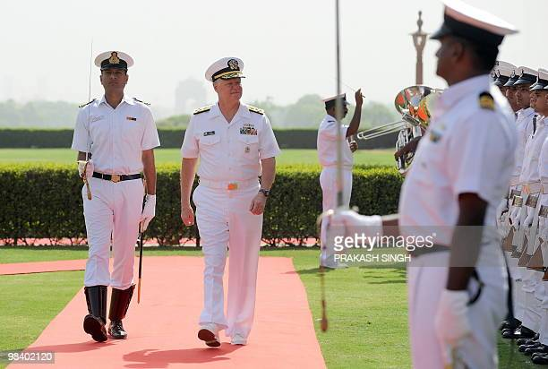 Chief of Naval Operations US Navy Admiral Dary Roughead talks with Indian navy Chief Admiral Nirmal Verma as they review an honour guard in New Delhi...