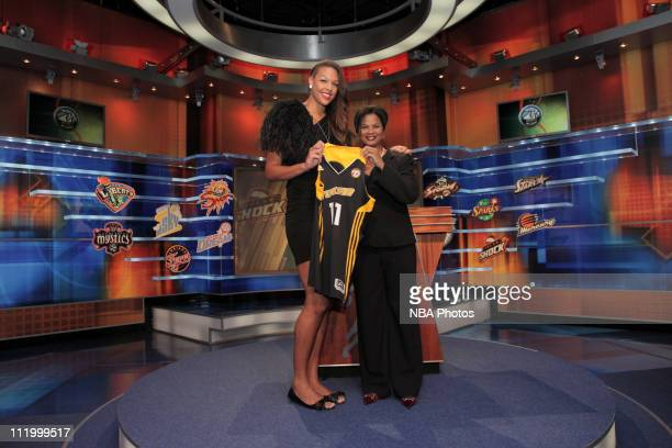 Chief of Operations and Player Relations Renee Brown poses with Elizabeth Cambage after being drafted number two overall by the Tulsa Shock during...