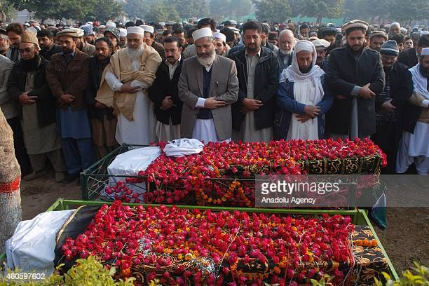 Chief of Pakistan's party of JamaatiIslami Siraj Ul Haq leads the funeral prayers of the victims of a Taliban attack at an armyrun school prior to...