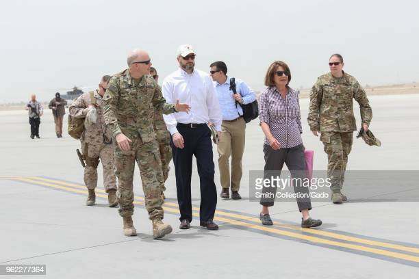 Chief of staff for Train Col Peter B Cross walking with congresswoman for the state of California Susan Davis at Kandahar Airfield Afghanistan May 14...