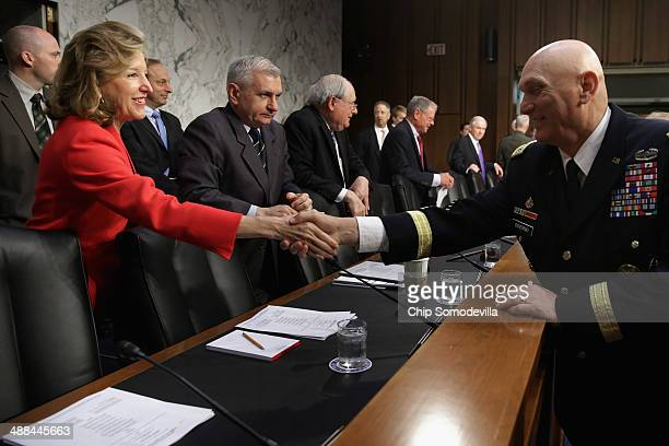 Chief of Staff of the Army Gen Raymond Odierno greets Senate Armed Services Committee committee member Sen Kay Hagan before Odierno and other members...