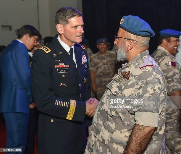 Chief of Staff of the Qatari Armed Forces General Ghanem bin Shaheen Al Ghanem shakes hands with CENTCOM Commander General Joseph L Votel during the...
