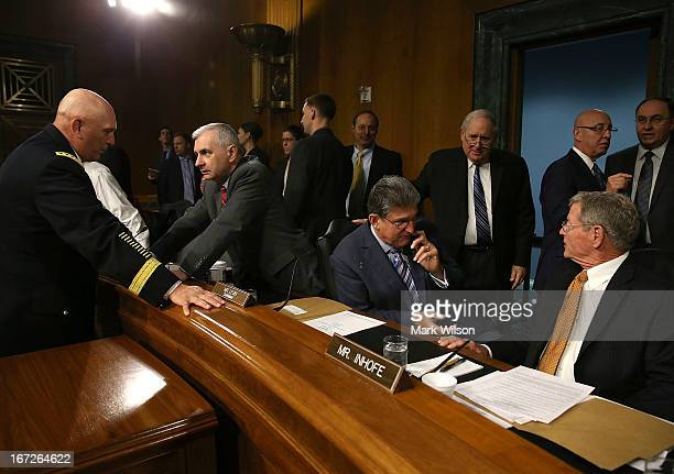 Chief of Staff of the U.S. Army Gen. Raymond Odierno , talks with Sen. Jack Reed while Senators Joe Manchin , Chairman Carl Levin and James Inhofe...