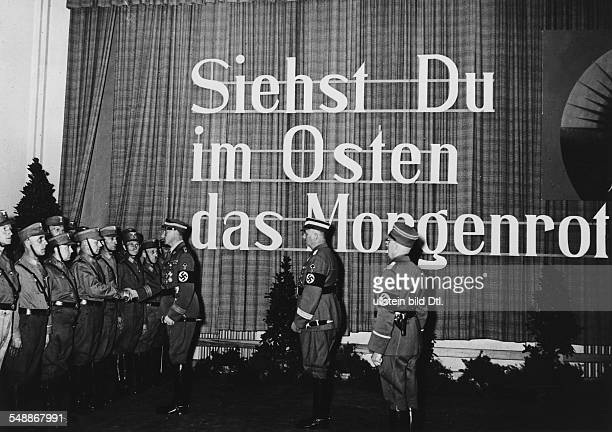 SA Chief of Staff Viktor Lutze welcoming SA men during a tour through Pomerania propaganda 'Siehst du im Osten das Morgenrot' Photographer...