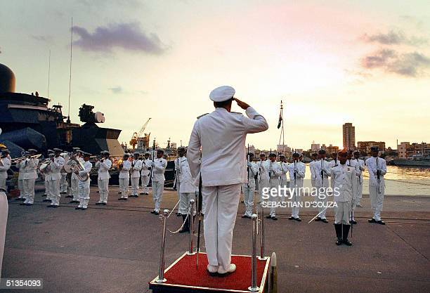 Chief of Staff Western Naval Command Rear Admiral Sanjeev Bhasin salutes the crew members of the INS Sindhudurg at the solemn decommissioning...
