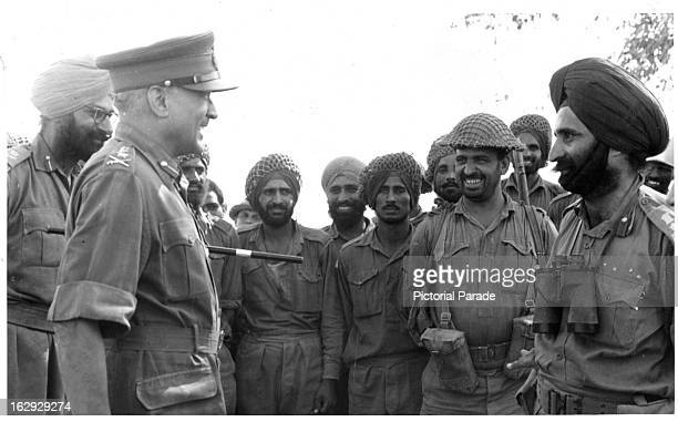Chief of the Army Staff General JN Choudhary talking to troops on the bank of the Ichhogil Canal near Lahore 9/23/1965