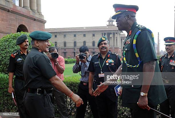 Chief of the Army Staff Ghana Major General Joseph Narh Adinkrah prepares to shake hands with Indian Army Chief General Vijay Kumar Singh in New...