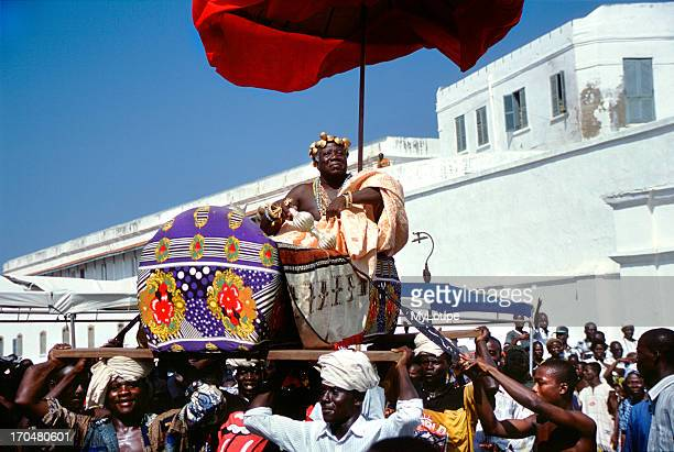 A Chief of the Central Region is carried aloft in a palanquin at a special Durbar on the grounds of Cape Coast Castle the Pan African Cultural...