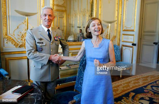 Chief of the Defence Staff of the French Army General Francois Lecointre shakes hands with French Minister defence minister Florence Parly prior to...