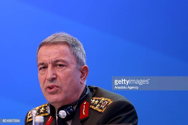 Chief of the General Staff of the Turkish Armed Forces Hulusi Akar delivers a speech during Defence and Security Committee as part of the NATO...