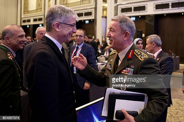 Chief of the General Staff of the Turkish Armed Forces Hulusi Akar talks with ViceAdmiral Clive Johnstone during Defence and Security Committee as...