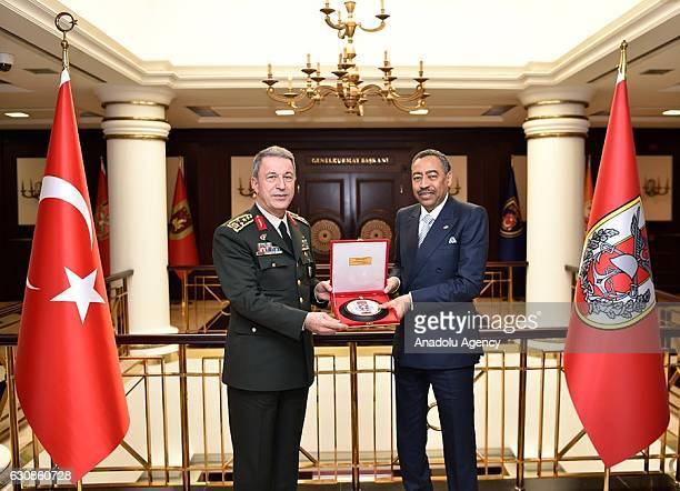 Chief of the General Staff of the Turkish Armed Forces Hulusi Akar and Deputy Defense Minister of Saudi Arabia Mohammed Abdullah Alayeesh pose for a...