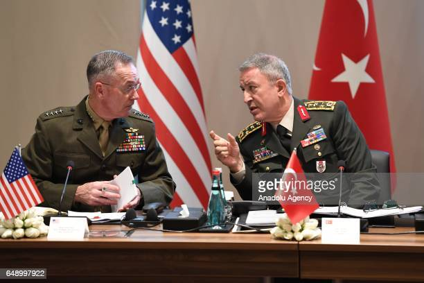 Chief of the General Staff of the Turkish Armed Forces Hulusi Akar talks with Chairman of the US Joint Staff General Joseph Francis Dunford during a...