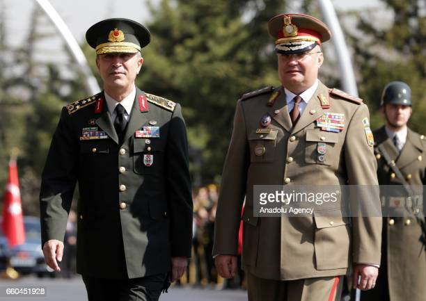 Chief of the General Staff of the Turkish Armed Forces Hulusi Akar and Lieutenant General NicolaeIonel Ciuca of Romania walk past the guard of honor...