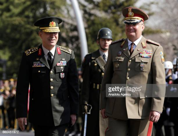 Chief of the General Staff of the Turkish Armed Forces Hulusi Akar stands next to Lieutenant General NicolaeIonel Ciuca of Romania during the...