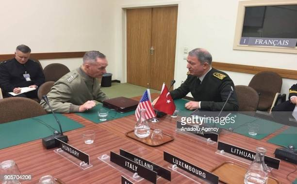 Chief of the General Staff of the Turkish Armed Forces Hulusi Akar chats with Chairman of the US Joint Chiefs of Staff General Joseph F Dunford...