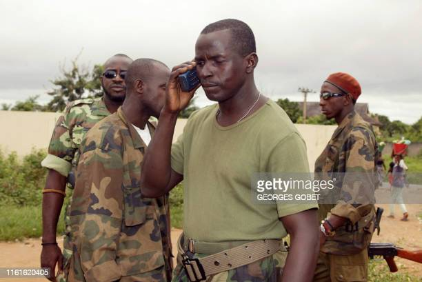 Chief of the rebel forces in the region of Bouake, adjutant Tuo Tozie talks to a journalist on a telephone in front of the headquarters of the 3rd...