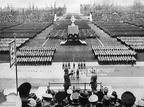 HIERL chief of the Reich work program and the Führer Adolf HITLER making the Nazi salute at the tribune of the Nuremberg Rally the 8th national...