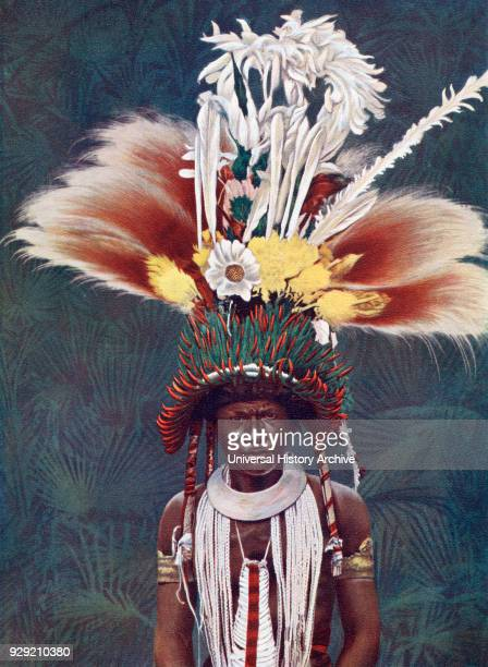 A chief of the Roro tribe from Papua New Guinea Melanesia decorated for a ceremonial dance The ornament hanging over the middle of his chest is the...
